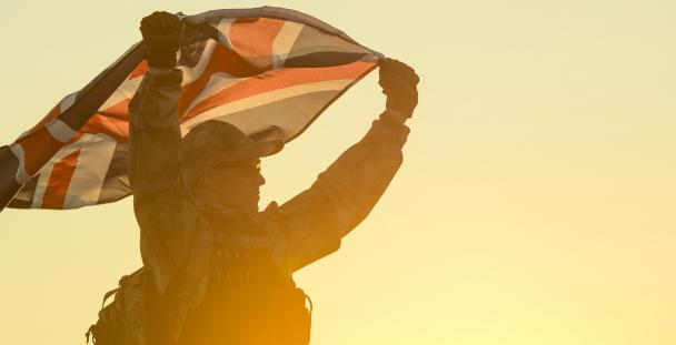 Image of a soldier holding a Union Jack flag