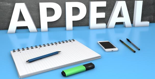 Image of desk stationery and the word appeal