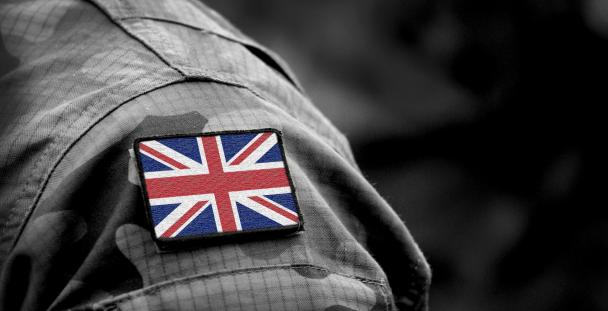 Arm of a person in the armed forces with Union Jack on sleeve