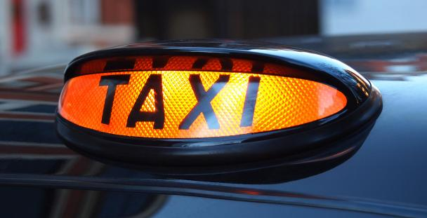 Image of a black cab taxi sign