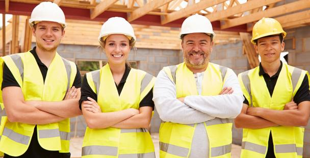 Image of a group of male and female builders in high visibility jackets