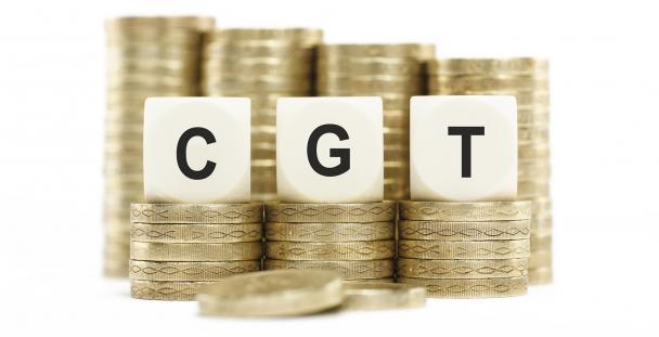 Image of piles of coins with the letters CGT in front
