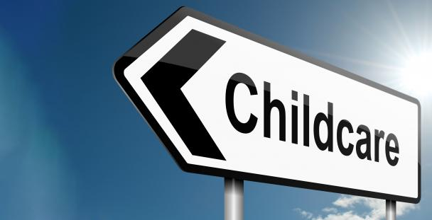 Signpost with the word childcare on it