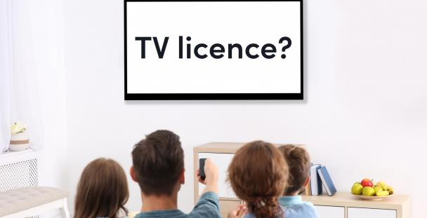 Image of family watching television with the words TV licence on the screen