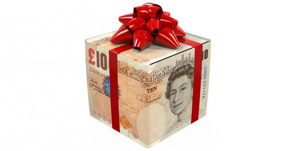Image of a gift box wrapped in ten pound notes