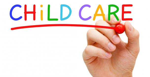 Image of a person writing the word childcare