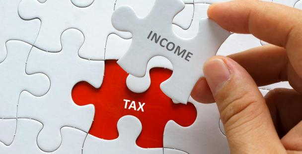 Income tax jigsaw pieces (c) Shutterstock / mozakim
