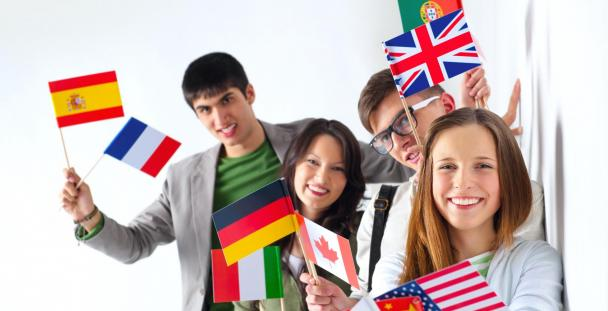 Image showing international students holding flags from around the world