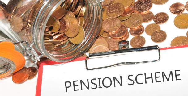 Image of a jar of coins with a clipboard in front including the words pension scheme