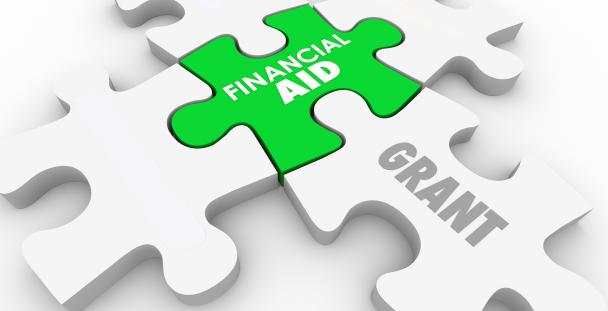 Illustration of jigsaw pieces displaying the words financial aid and grants