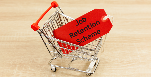 Image of miniature shopping trolley with a job retention scheme tag inside