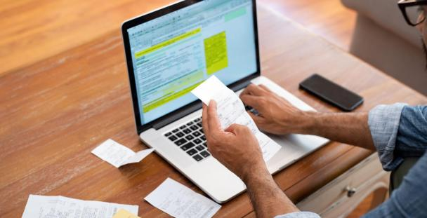 man checking expenses to claim tax back online