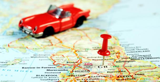 Image of a miniature car sitting on a UK map