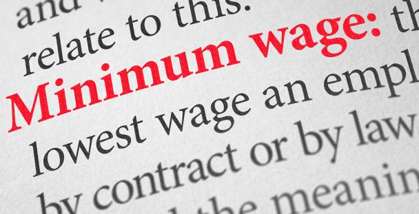 Image of a dictionary displaying the term minimum wage