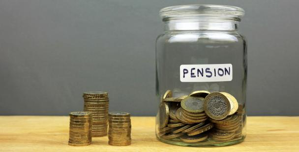 Pension jar with pound coins inside and outside it