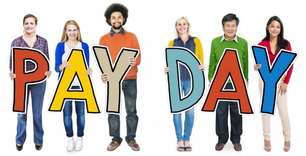 People holding letters spelling pay day