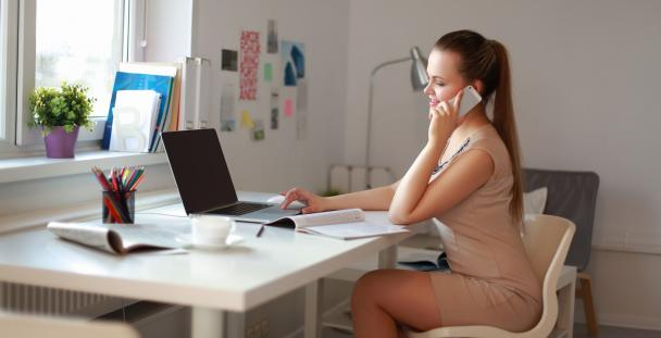 self-employed woman working at her desk