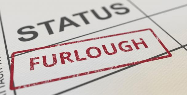 The word furlough stamped on a piece of paper