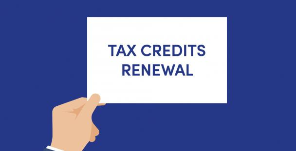 Illustration of a hand holding a sign saying tax credits renewal