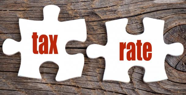 Jigsaw pieces displaying the words tax rate (c) Shutterstock / kenary820