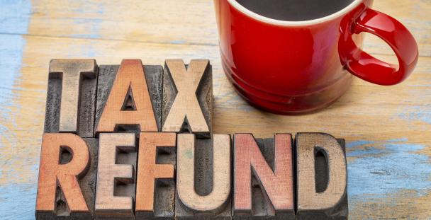 Image of the words tax refund and a mug of coffee