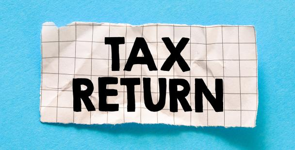 Illustration of tax return written on a piece of paper