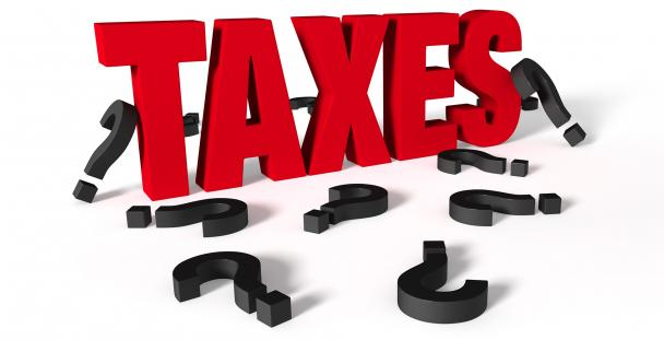 Illustration of the word taxes surrounded by question marks
