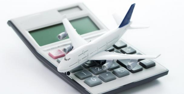 Image of toy aeroplane on a calculator illustrating travel expenses