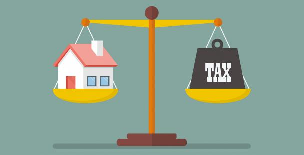 Illustration of a house and the word tax on a set of scales