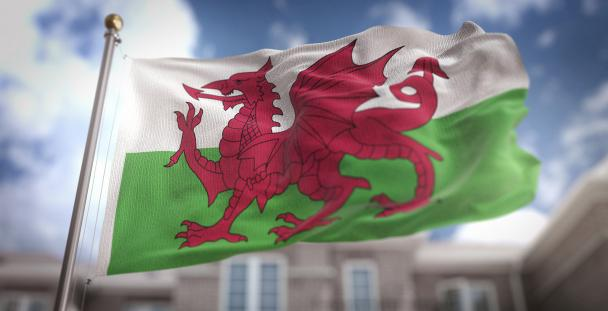 Image of the Welsh flag in front of a building
