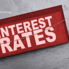 Illustration of two people pulling a block with the words interest rates on it
