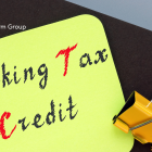 Image of a sticky note with working tax credit written on it