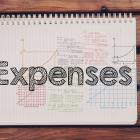 Image of the word expenses written on a notepad