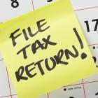 Image of a sticky note saying file tax return