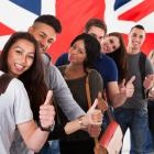 Group of international students in front of a Union Jack flag