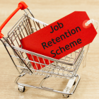 Image of a miniature shopping trolley with a job retention scheme tag inside