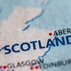 Image of Scotland on a map with a pin next to it