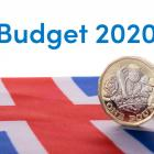 Pound coin on Union Jack flag representing the 2020 Budget